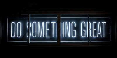 sign in the dark saying in blue colour Do Something Great
