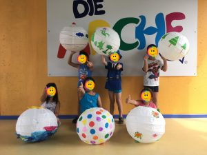 "Children from ""Die Arche e.V."" holding their designed lampshades"