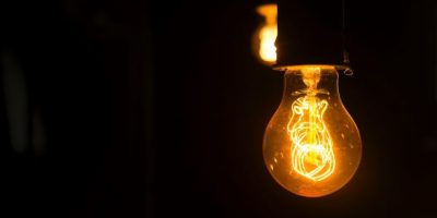 A bulb is hanging in a dark room