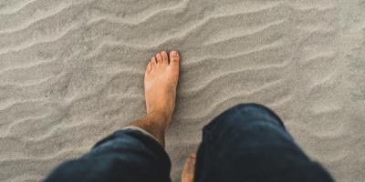 Someone walks on sand